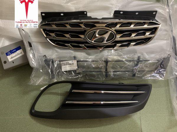 Mặt galang Hyundai Genesis 2009 863502M010